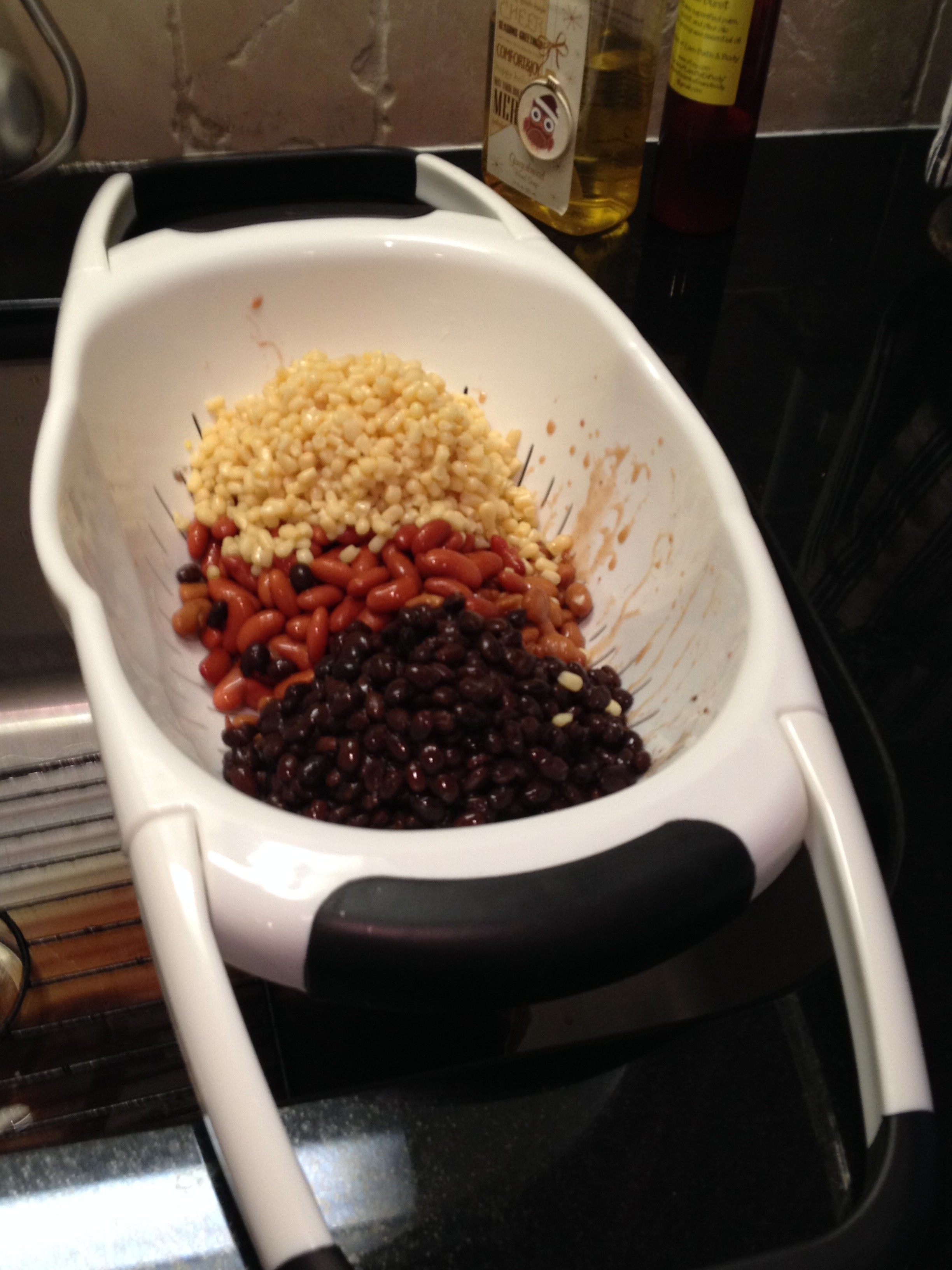 Drain beans and corn in colander.  Tidbit Tip:  This is a great colander because the handles fold out and fit over the sink allowing you to use both hands.