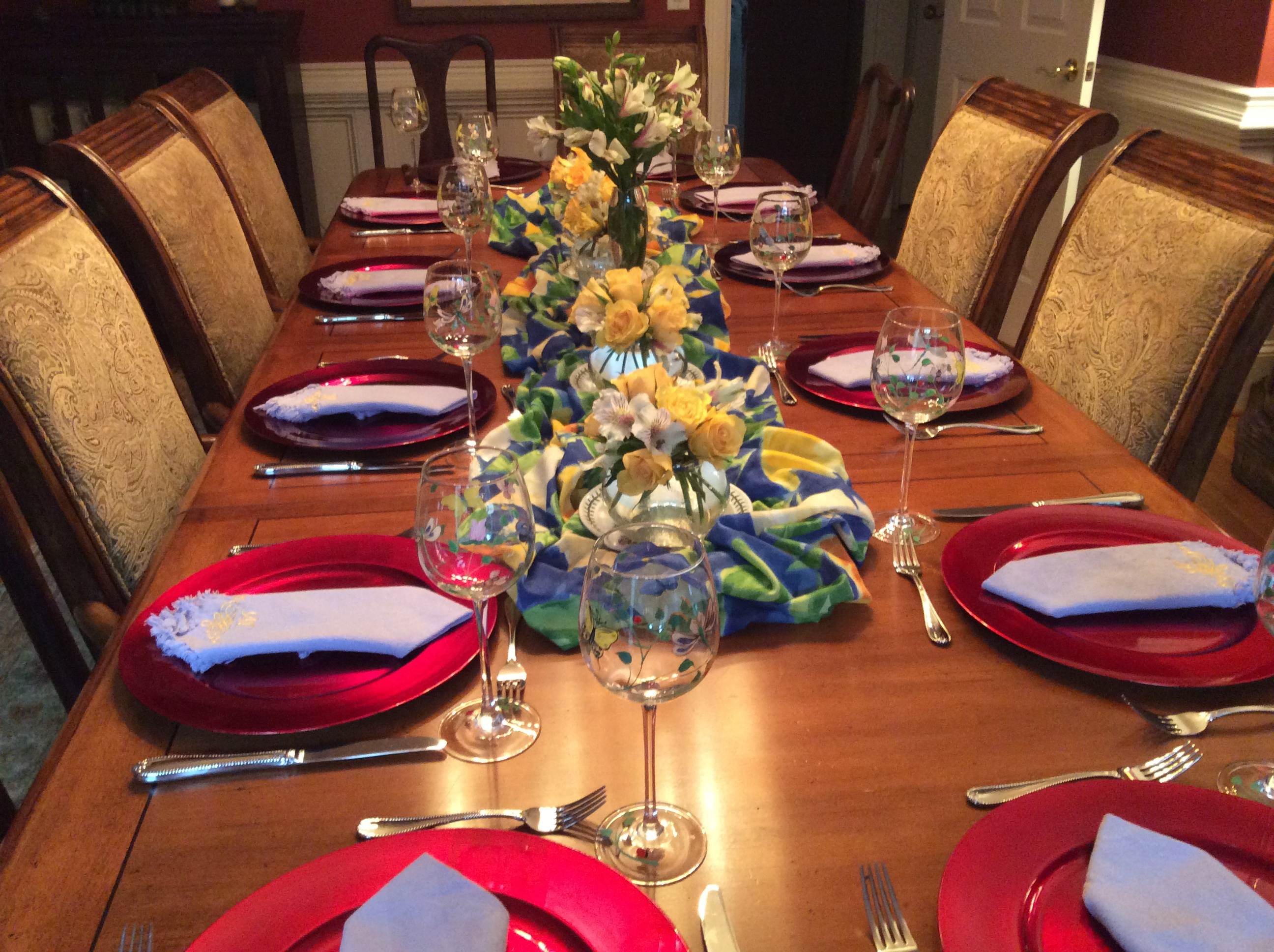 Set a pretty table with flowers and fabric down the middle.