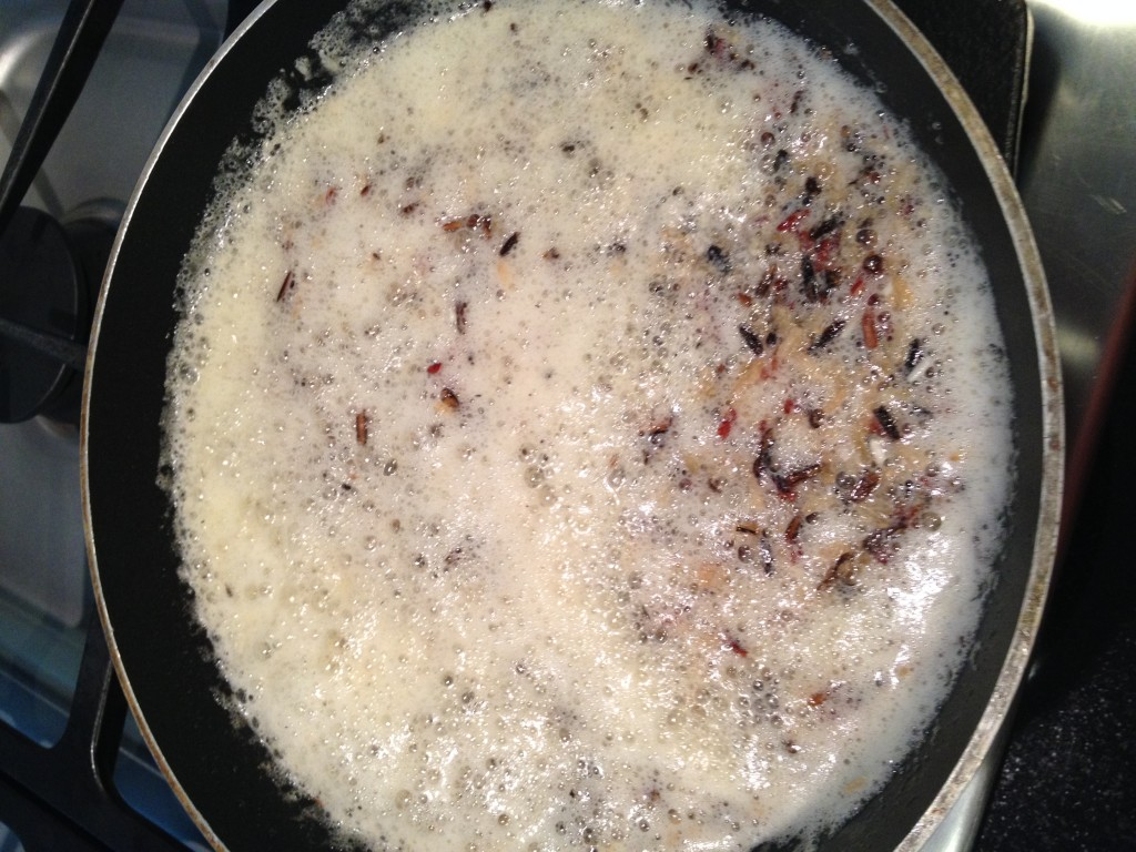 Rice Browning in Hot, Bubbling Butter - Tidbit Tip:  Watch carefully - it browns quickly.  The dark you see is the black rice.