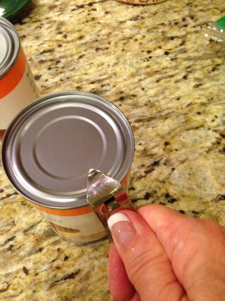 Opening cans of chicken broth