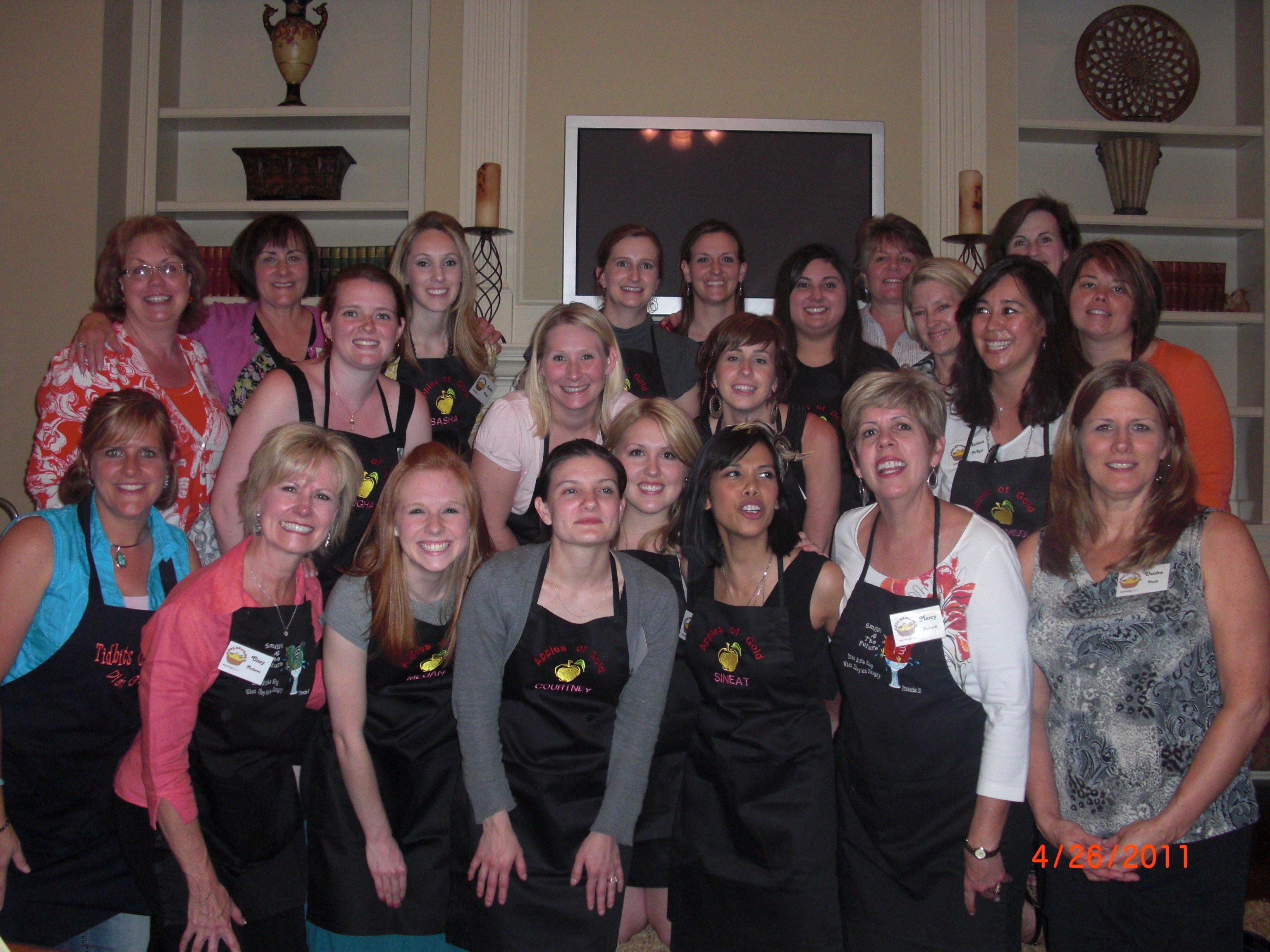 "Mentoring Young Women with some of my ""Best Girlfriends"". We teach hospitality, cooking and mentoring classes in my home. Beautiful Group of women. I am on the front row far left."