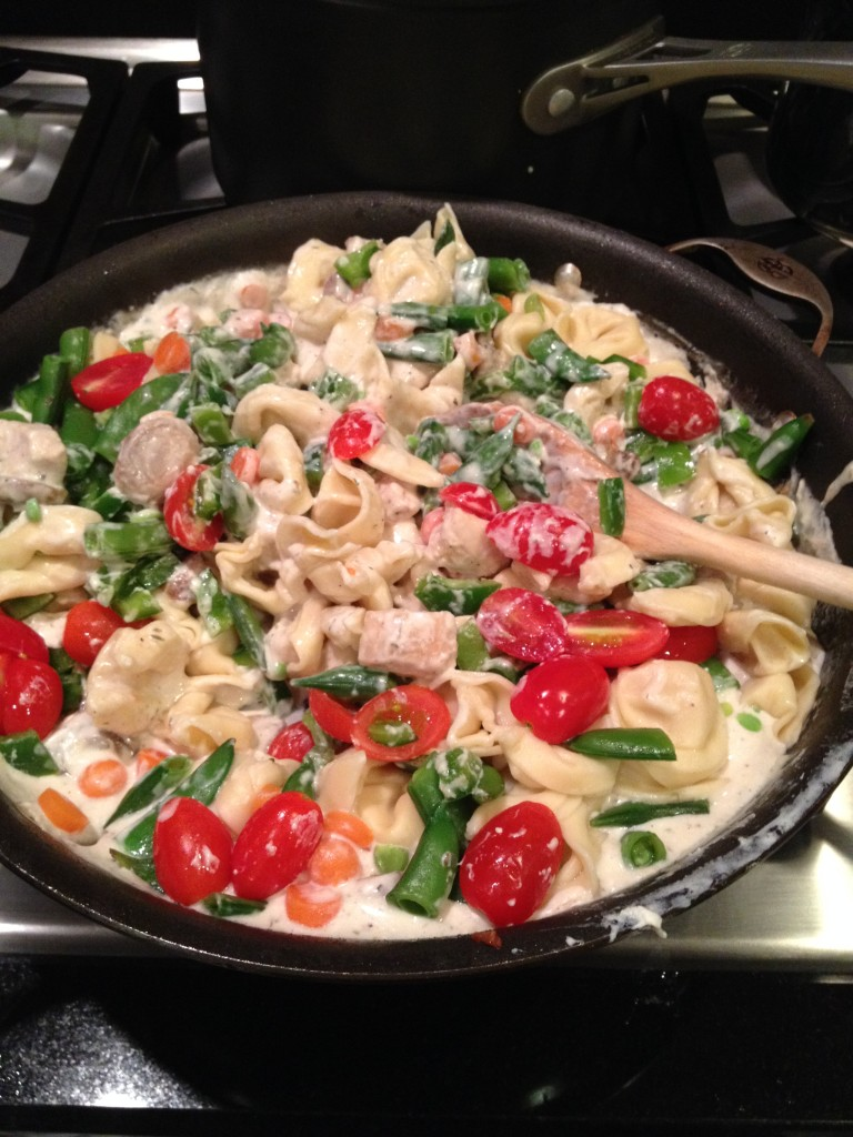 Add Chicken and mushrooms, chopped pepper and halved cherry tomatoes; stir to coat with sauce.