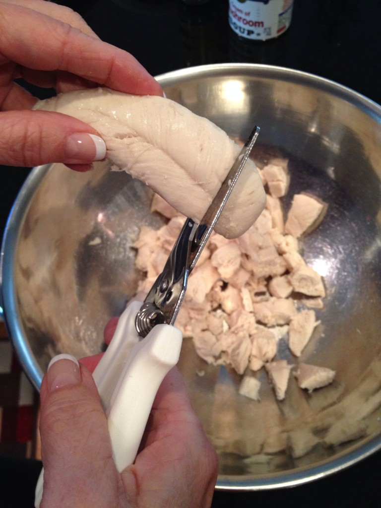 Cut cooked chicken into cubes with Kitchen Shears.