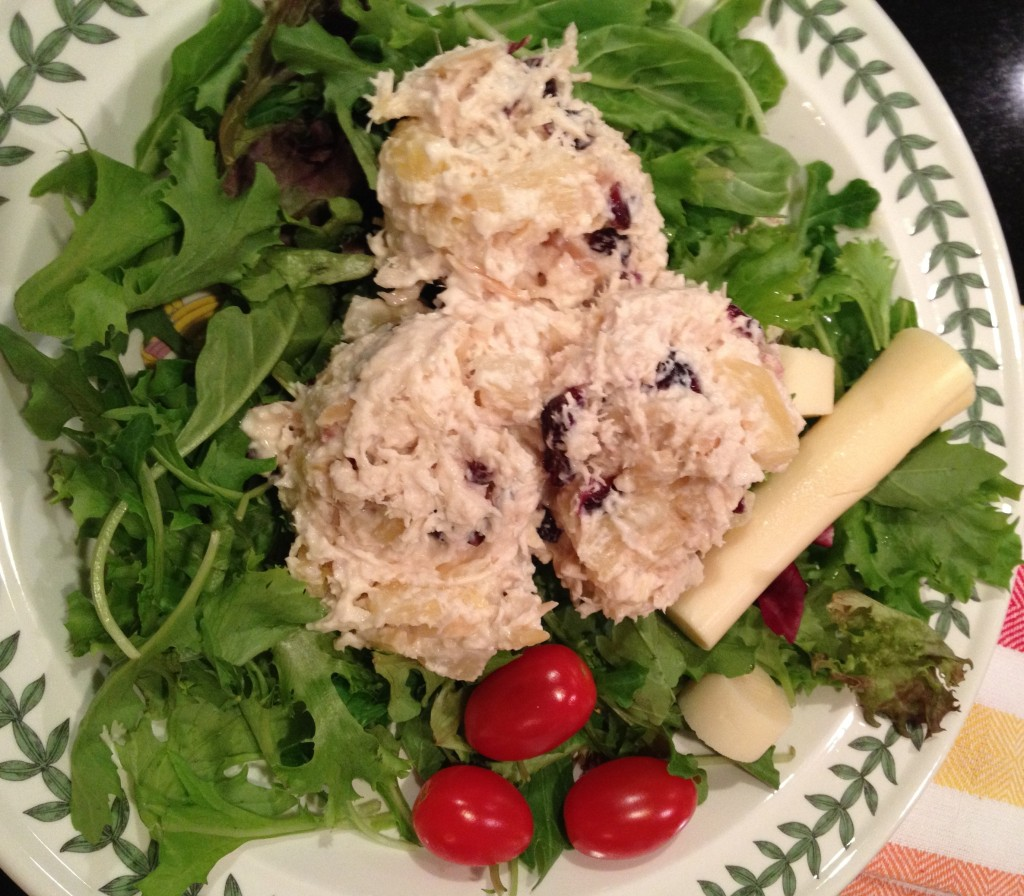 Serve Chicken Salad on lettuce with hearts of palm and cherry tomatoes.
